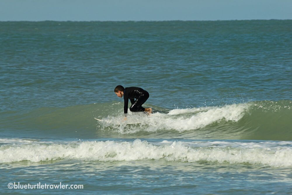 Corey gets up on a wave