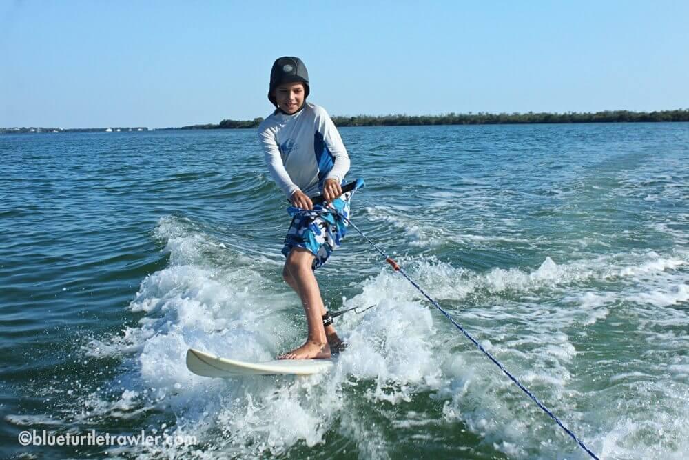 Dinghy surfing to the sandbar
