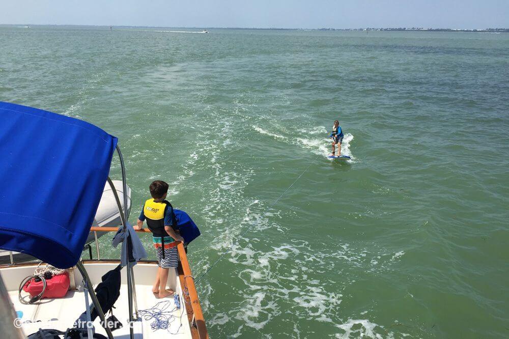 Corey trawler surfs as Sam looks on