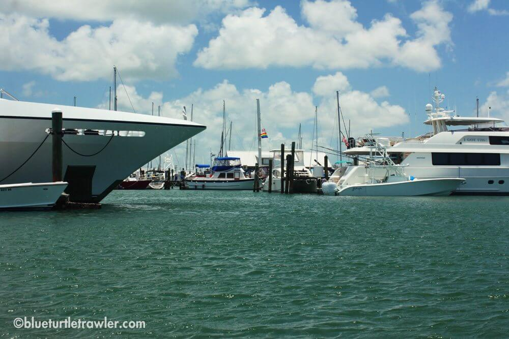Blue Turtle dwarfed by some very large yachts