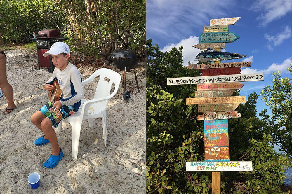 Corey playing uke and signs posted on Picnic Island