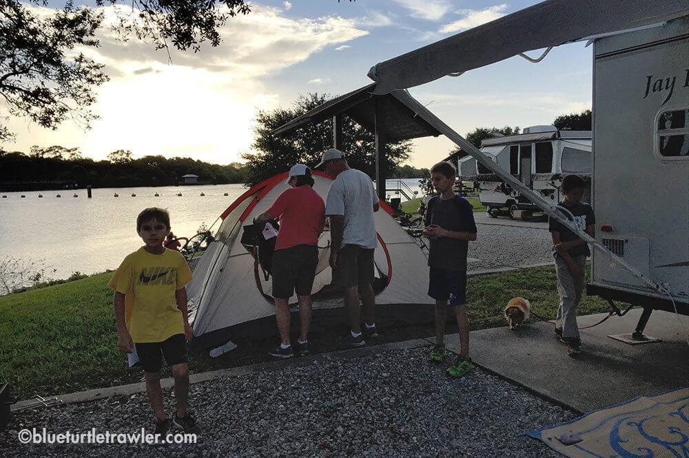Grandma and Grandpa help the boys get their tent setup