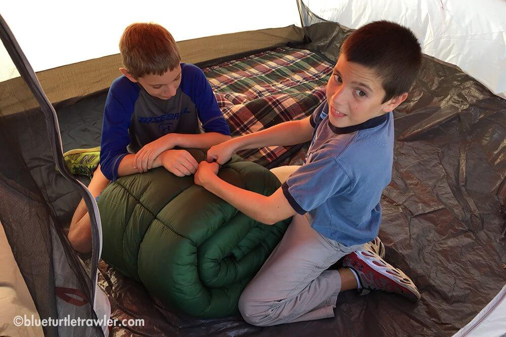 Corey and Jack get the sleeping bags ready