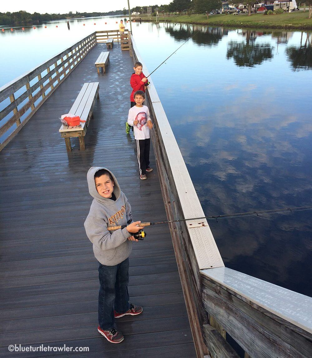 The boys fishing off the pier