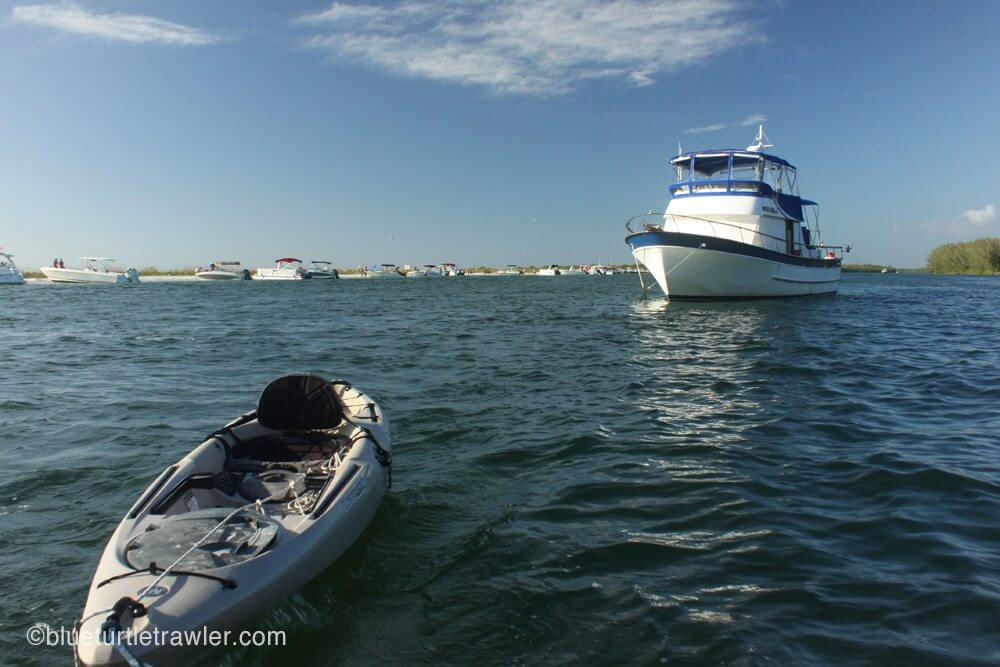 Dinghy'ing to shore with a kayak in tow