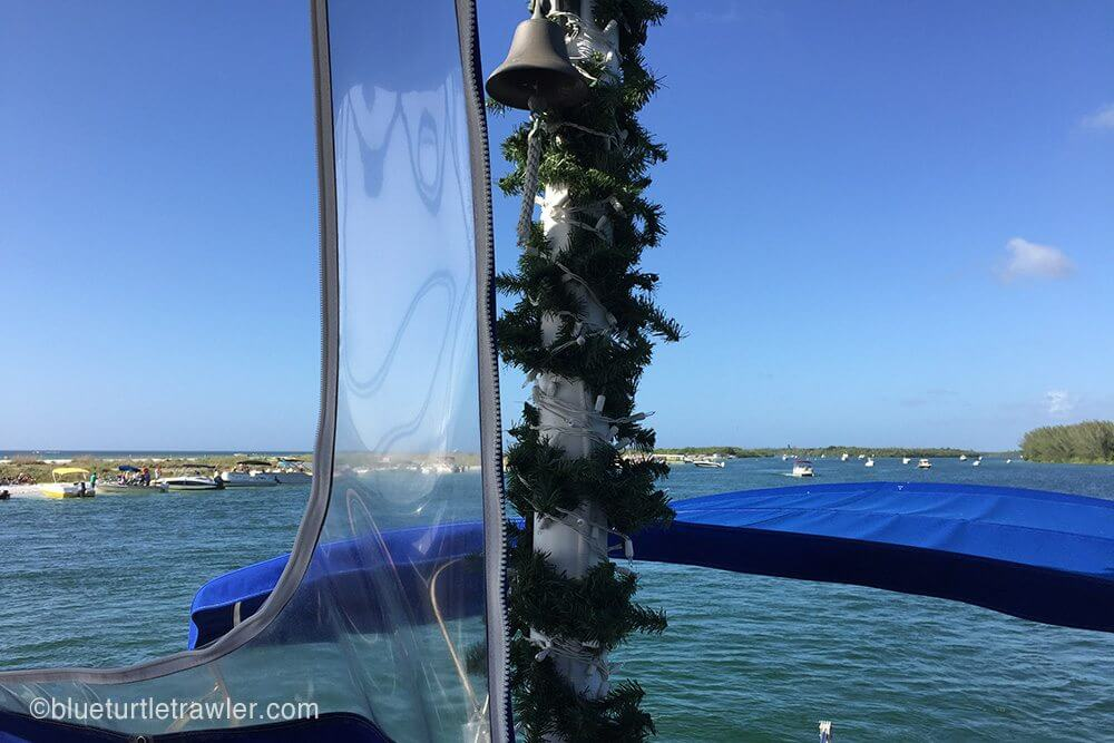 Our mast sporting garland and lights