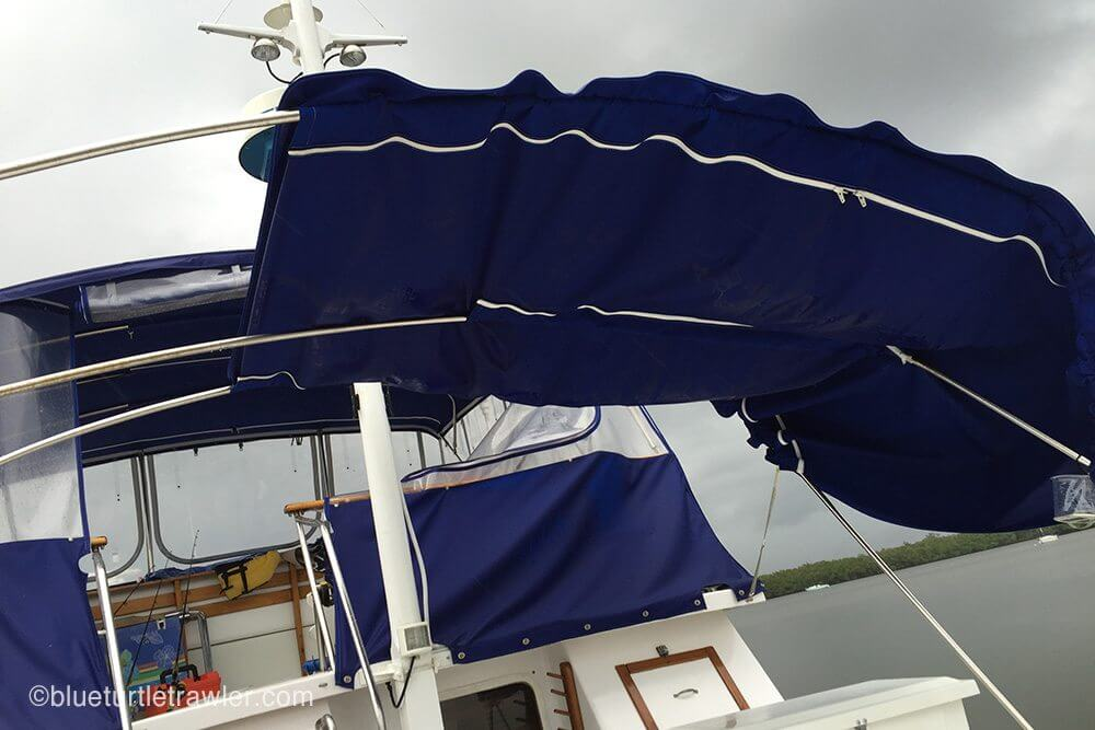 The wind pushed our canvas to one side on our rear deck bimini. Luckily, we were able to restore it.