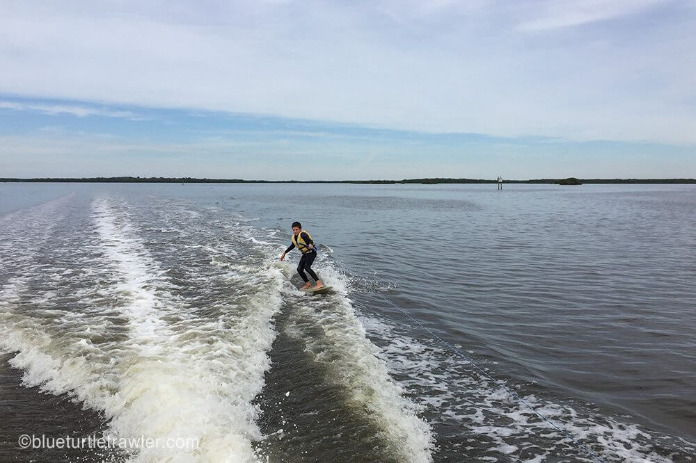 Corey skimming behind the pontoon boat (this board has no fin!)