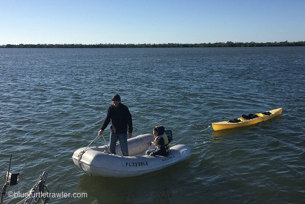 Corey helps Grandpa rescue a kayak that got loose during the windy night