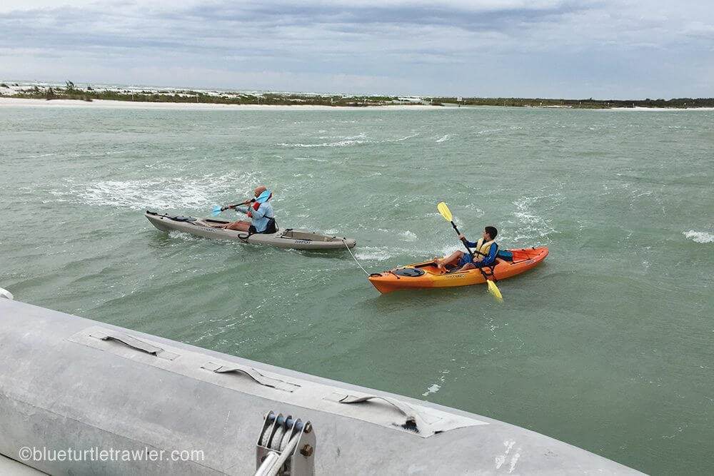 The boys paddling against the wind