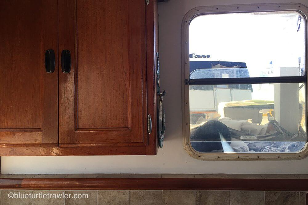 Galley window and around cabinets (blinds and wood covers removed)
