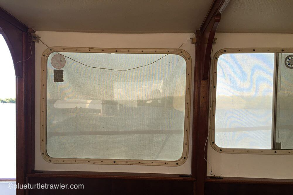 Port side windows after paint (with blinds and wood panel covers off)