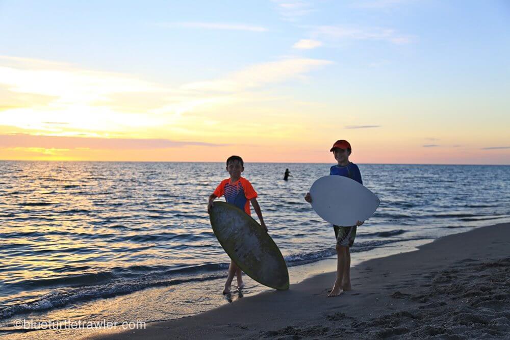 Sam and Corey skim boarding
