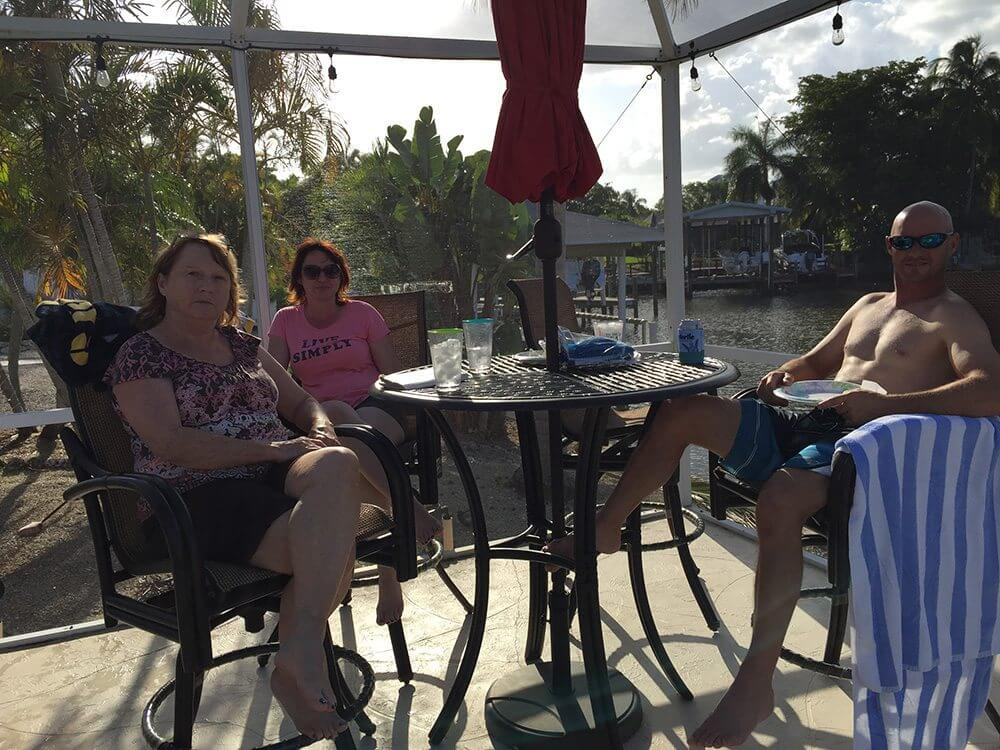 Randy with his mother and sister at their rental house