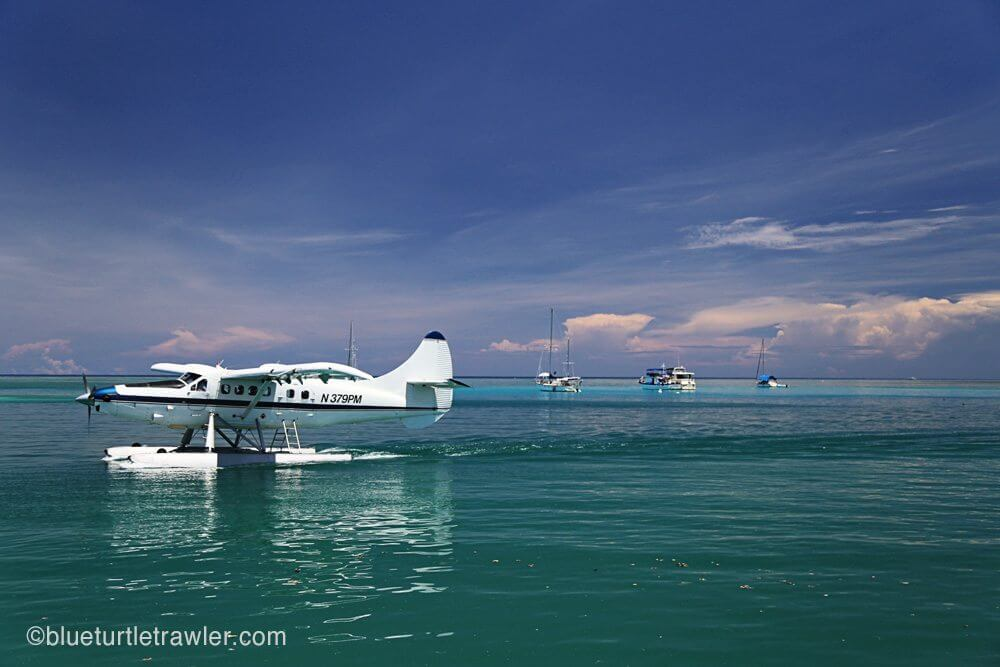 Sea plane with our flotilla in the background