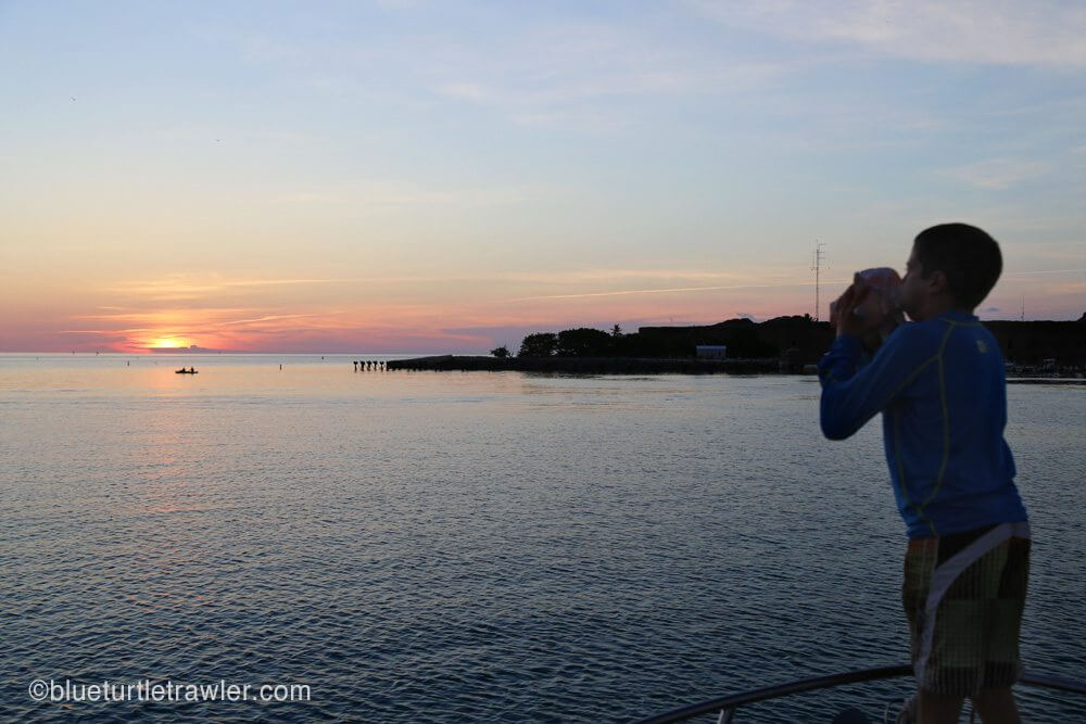 Corey blows the conch for sunset