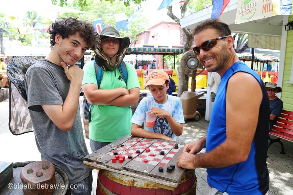 The boys play some checkers before the tour