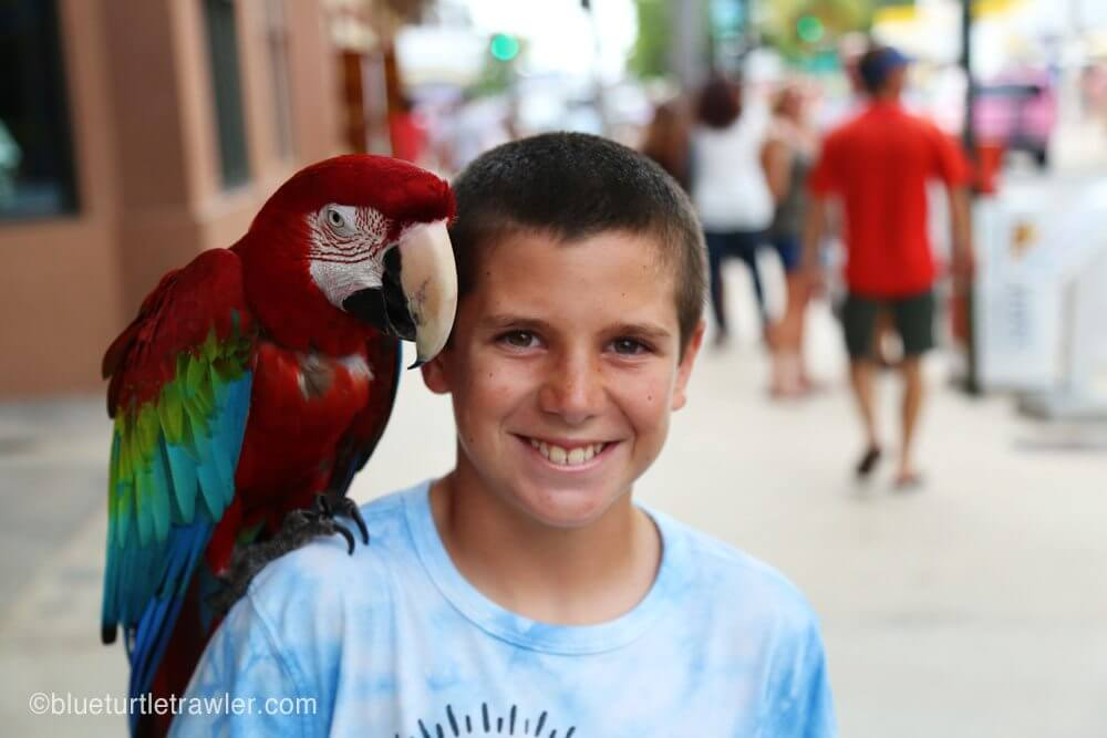 Corey get's his photo with Margarita the parrot