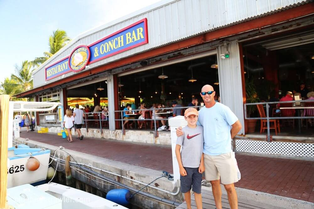 The boys in front of the Conch Republic Restaurant