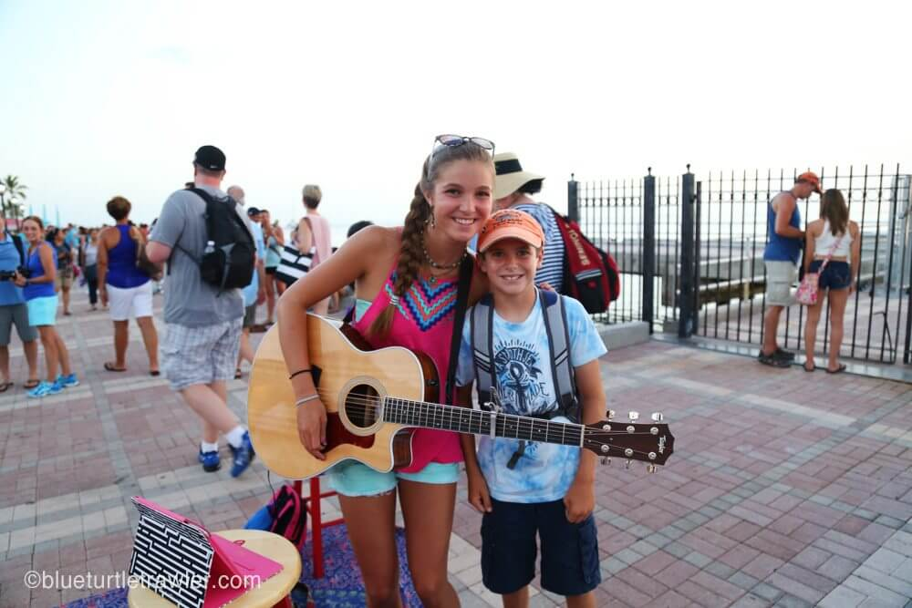 Corey poses with the talented young lady singing at Mallory Square