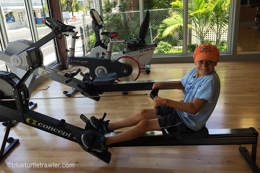 Corey working out on the rowing machine at Key West 24 Hour Fitness