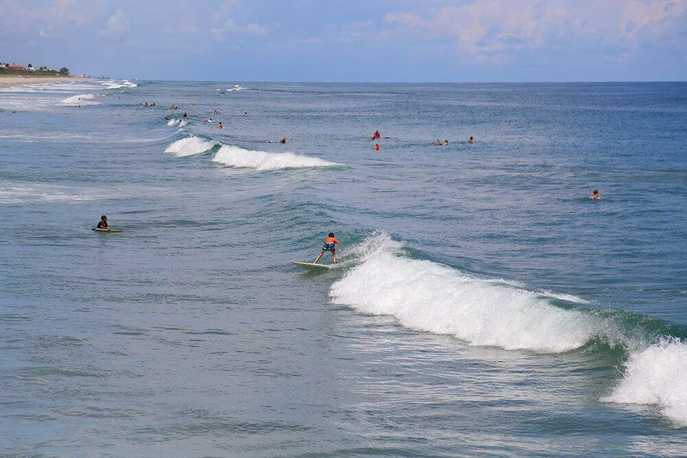 Corey surfing at Sebastian Inlet