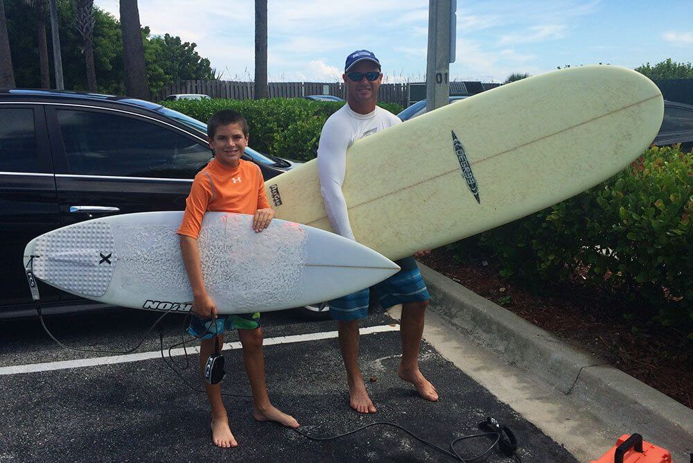 The boys heading out to surf