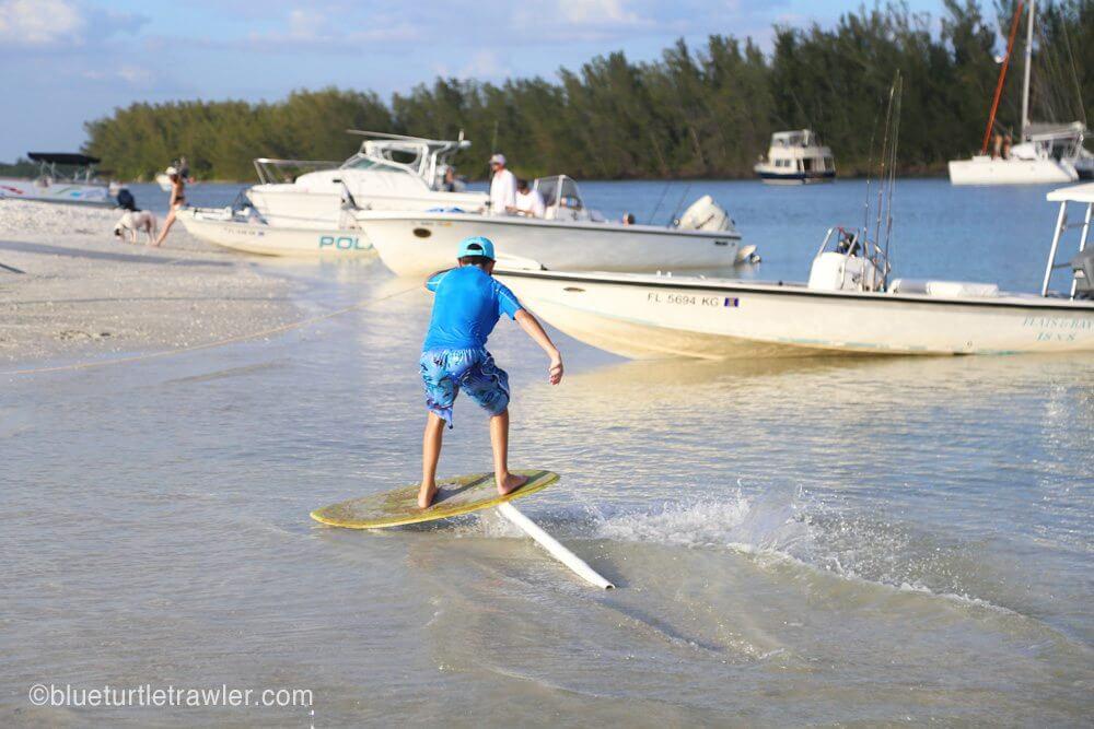 Corey tests out his new custom-built skim board ramp