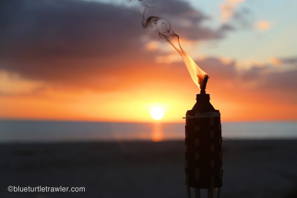 Tiki torch and sunset