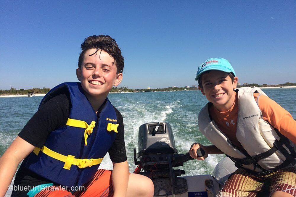 two boys smiling in dinghy