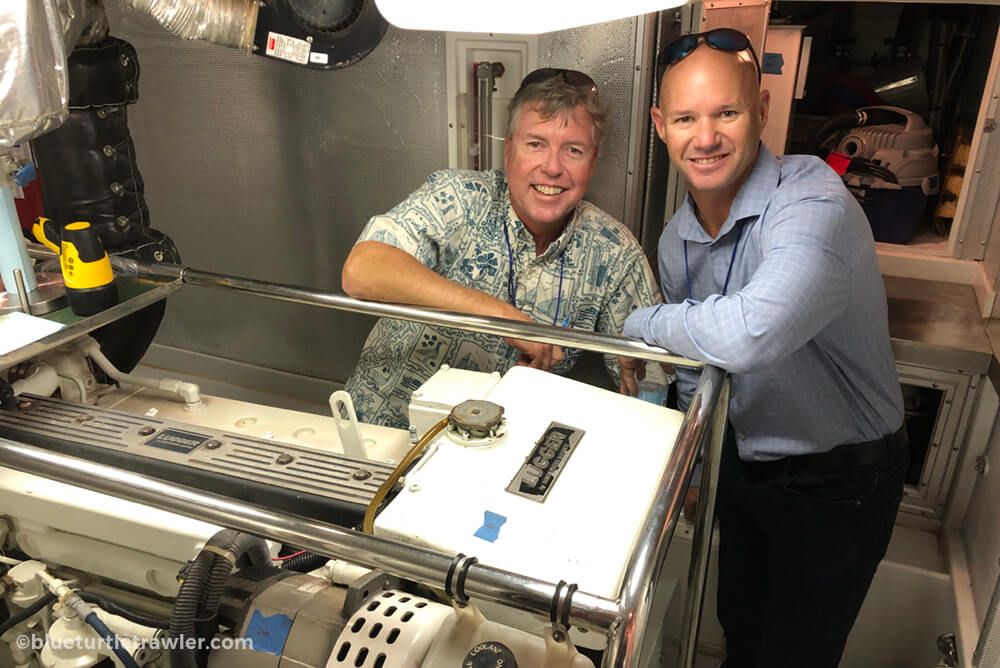 Jeff Merril and Randy inspecting the engine room of the Nordhavn 47