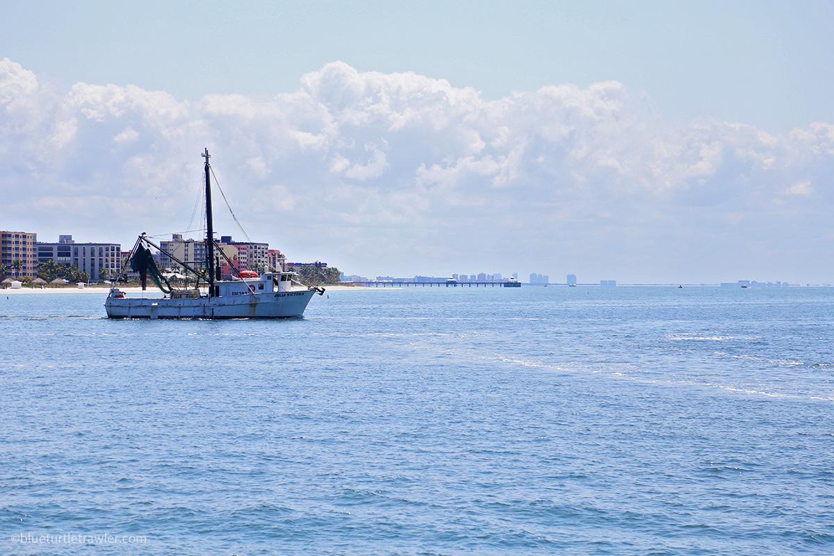 Shrimp boat cruising off fort myers beach