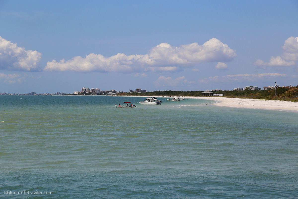 small boats anchored off a beach