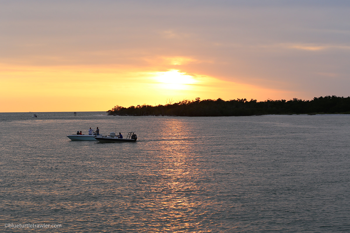 boats with sunset in background